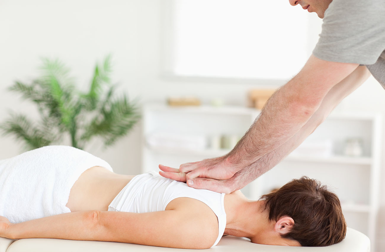 Chiropractor treating patients back